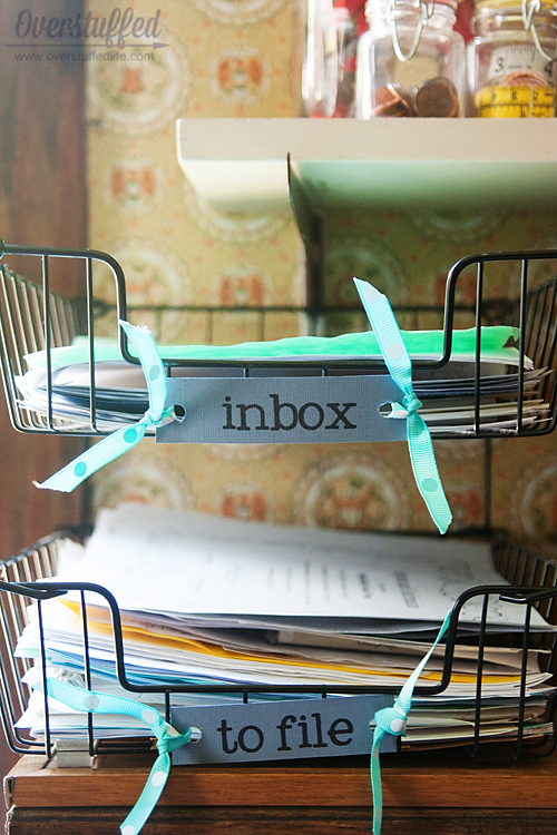 "Keep designated ""inbox"" and ""to file"" baskets, and sort through them often."
