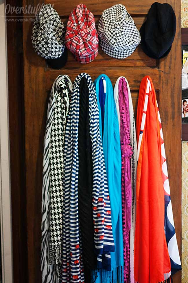 Use the closet door to keep things like scarves and hats organized.
