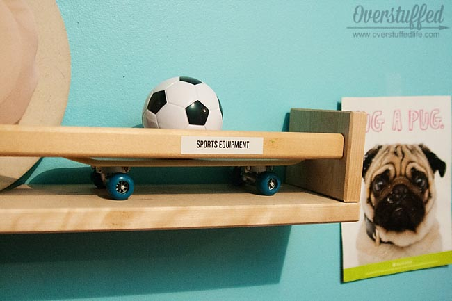 Labeling things that aren't obvious is helpful to kids when it comes to keeping their toys organized.