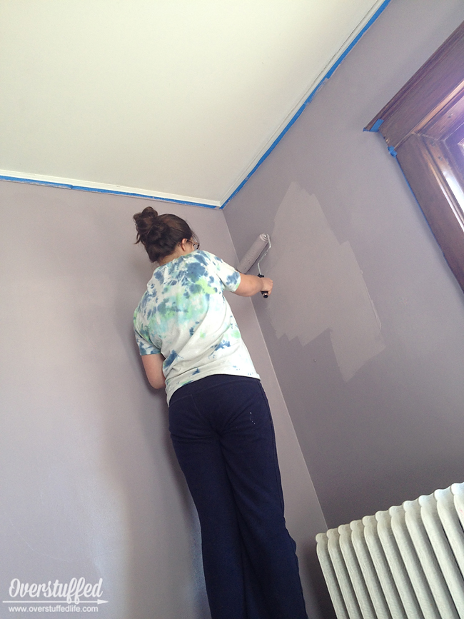 My teenager painting my bedroom in Sherwin Williams Beguiling Mauve.