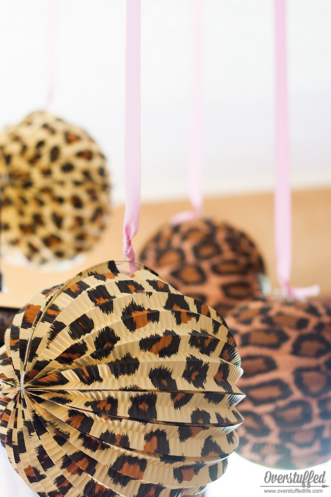 Cheetah and leopard printed paper lanterns are an easy party decoration for your cheetah themed birthday party. #overstuffedlife