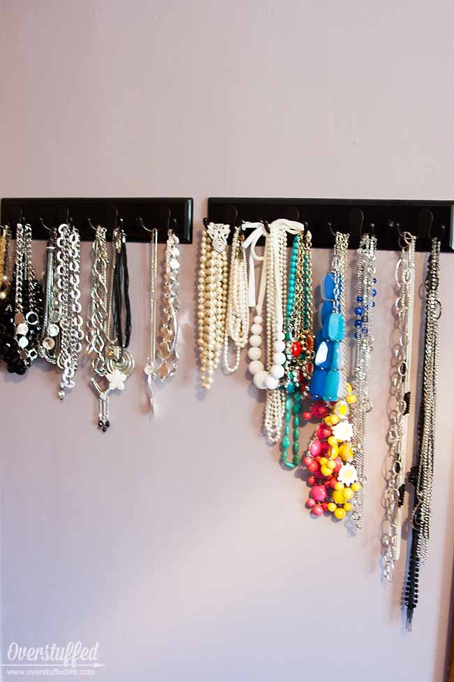 Use coat hooks to organize your necklaces by type, length, and color. #overstuffedlife