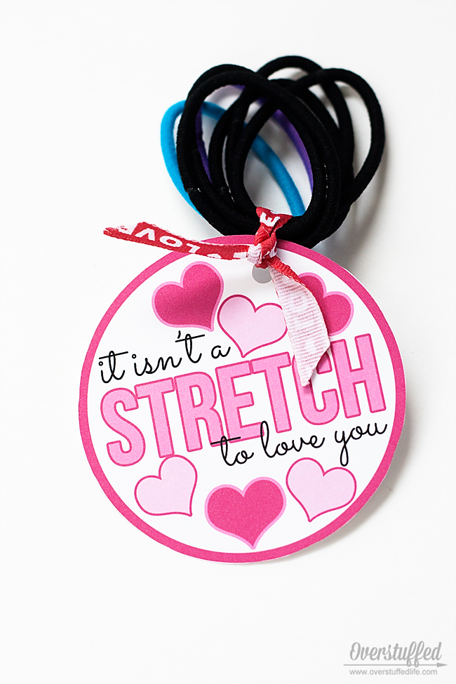 This cute Valentine's Day printable is meant for use with hair elastics. #overstuffedlife