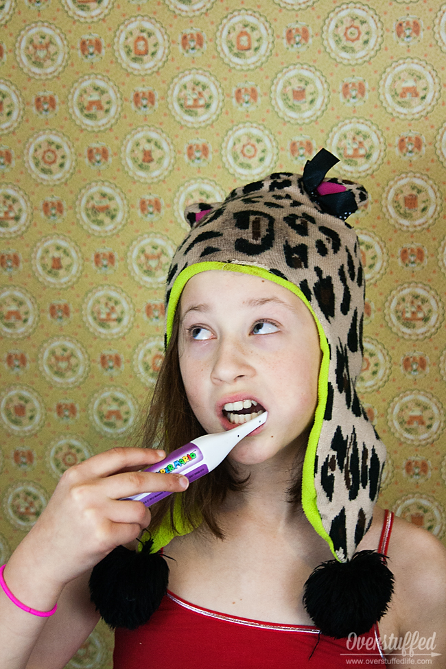 Do you tell your kids to brush their teeth 100 times a day? Stop the nagging and start doing this simple trick and watch those teeth get brushed happily! #overstuffedlife
