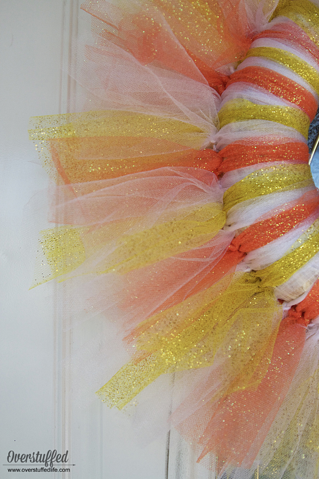 Cute candy corn wreath for Halloween. So simple to make that your kids can help, too!
