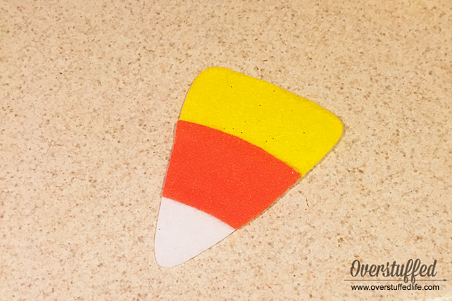 Add orange and yellow felt cut outs to the stiff white felt to make a cute candy corn decoration