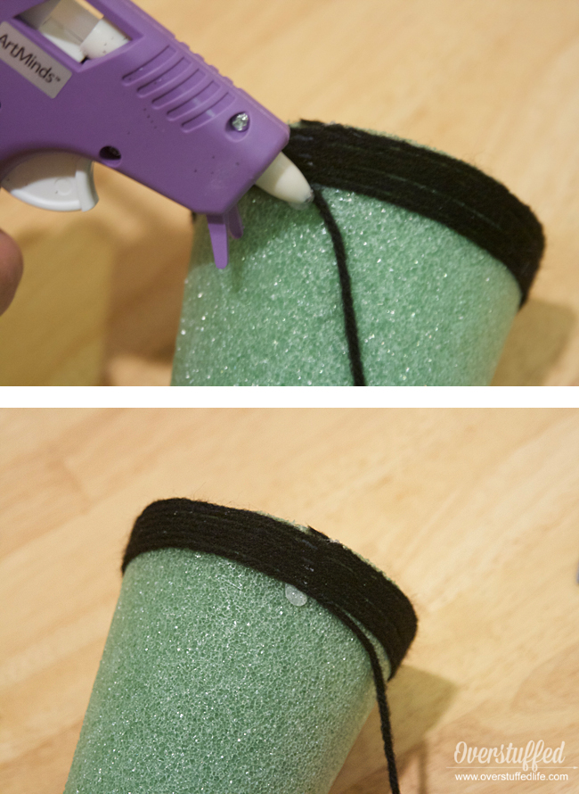 How to glue yarn onto foam cones to make Halloween witch hats.