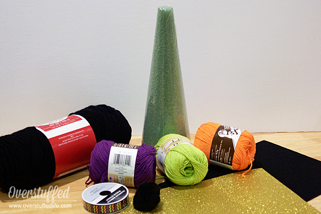 Supplies needed to make yarn witch hats.