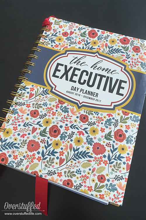 The Home Executive Day Planner features recipes, lots of planning space, a folder, and cute stickers to help you plan your day.